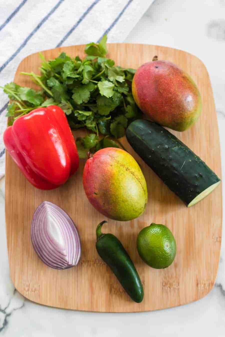 Vibrant, bright flavors come together in my Mango Salsa with red bell pepper, cucumber, red onion, cilantro, lime juice, and of course, the star of this show: fresh mango!