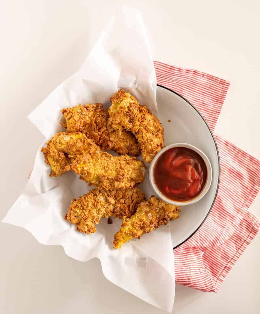 This step-by-step guide for how to make homemade chicken strips in the air fryer yields perfectly crunchy and crispy chicken strips, without the mess and mayhem of traditional frying methods!