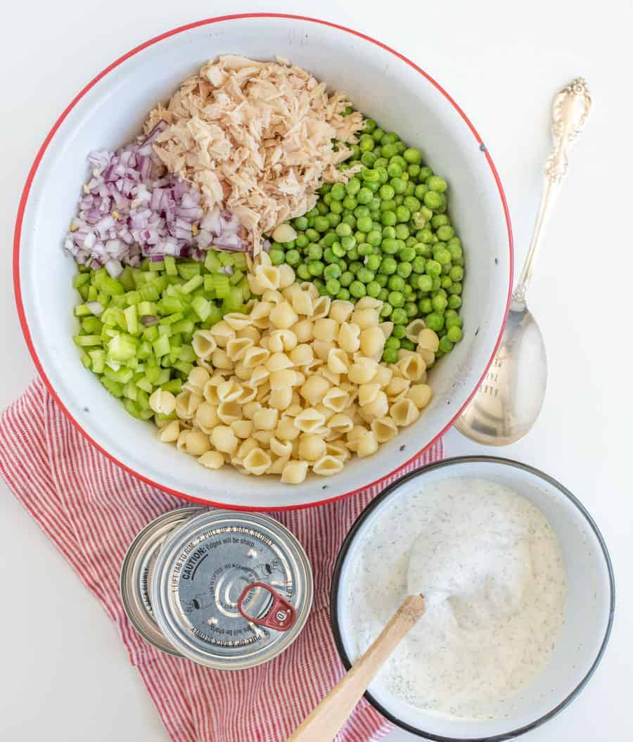 A light and refreshing Classic Tuna Pasta Salad comes together as the perfect summer side dish with white tuna, shell noodles, celery, peas, and a creamy dill sauce.