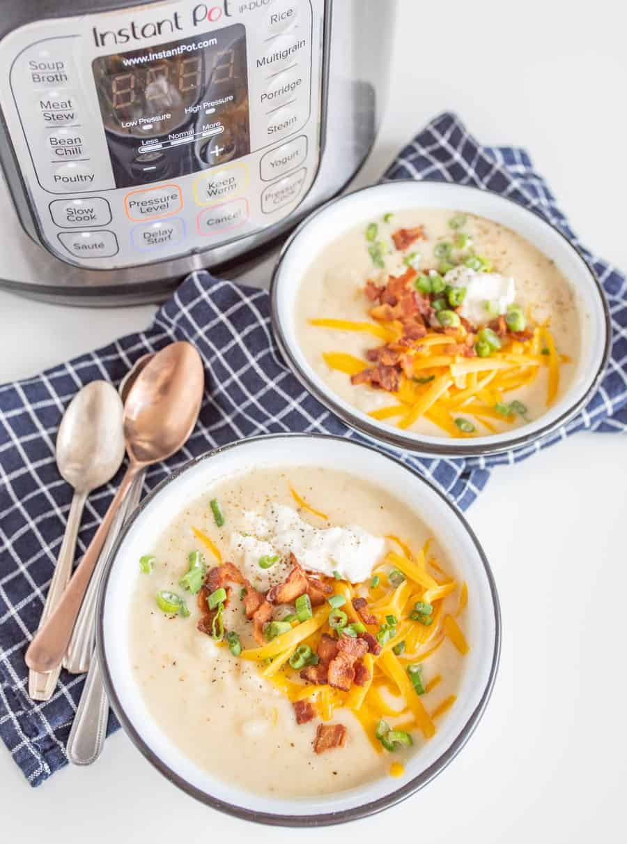 All the heartiness of a baked potato comes together in this rich and fast-as-can-be Instant Pot Loaded Baked Potato Soup, topped with shredded cheddar, crispy bacon bits, green onion, and sour cream.