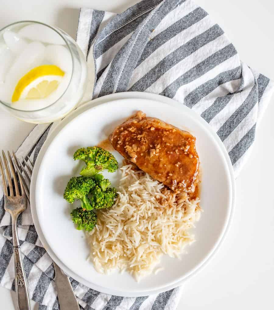 Vibrant and hearty, Slow Cooker Honey Garlic Pork Chops come together super fast with minimal ingredients--pork chops, salt and pepper, garlic, honey, soy sauce, and ketchup--and a few hours of cook time in the slow cooker.