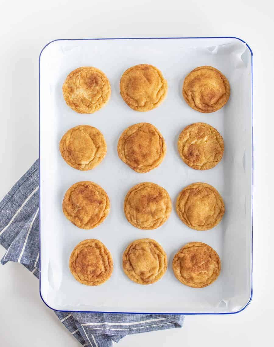 Chewy and decadent, Extra Soft Snickerdoodle Cookies are sweet and buttery with a lovely kick of warmth from the cinnamon-sugar coating.