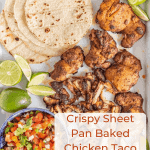 This smoky and Crispy Sheet Pan Baked Chicken Taco Meat creates tender bites of chicken thigh with the use of lime, cilantro, cumin, chili powder, and more savory spices that are perfect to wrap up in tortillas.