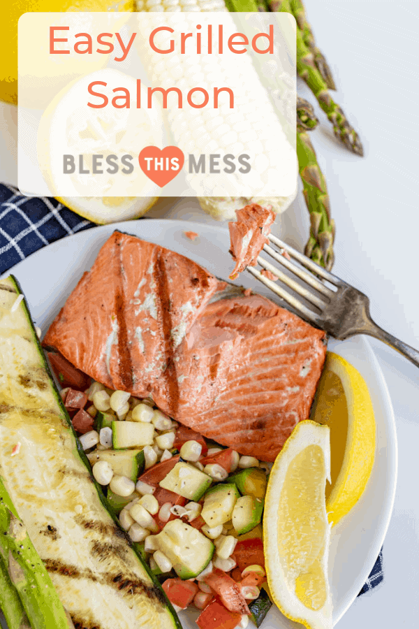 Pinterest Image for Easy Grilled Salmon with a top view of a plate with grilled salmon and a variety of vegetables