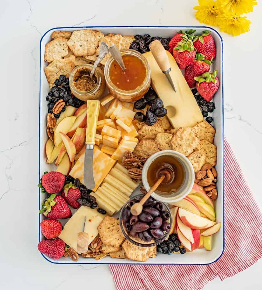 The options are endless for this Everyday Cheese Board, but the trick is to get a solid combination of flavors, textures, and colors on the board! I like cheddar, Colby jack, and Swiss cheeses with jam, mustard, various types of crackers, olives, and fruit.