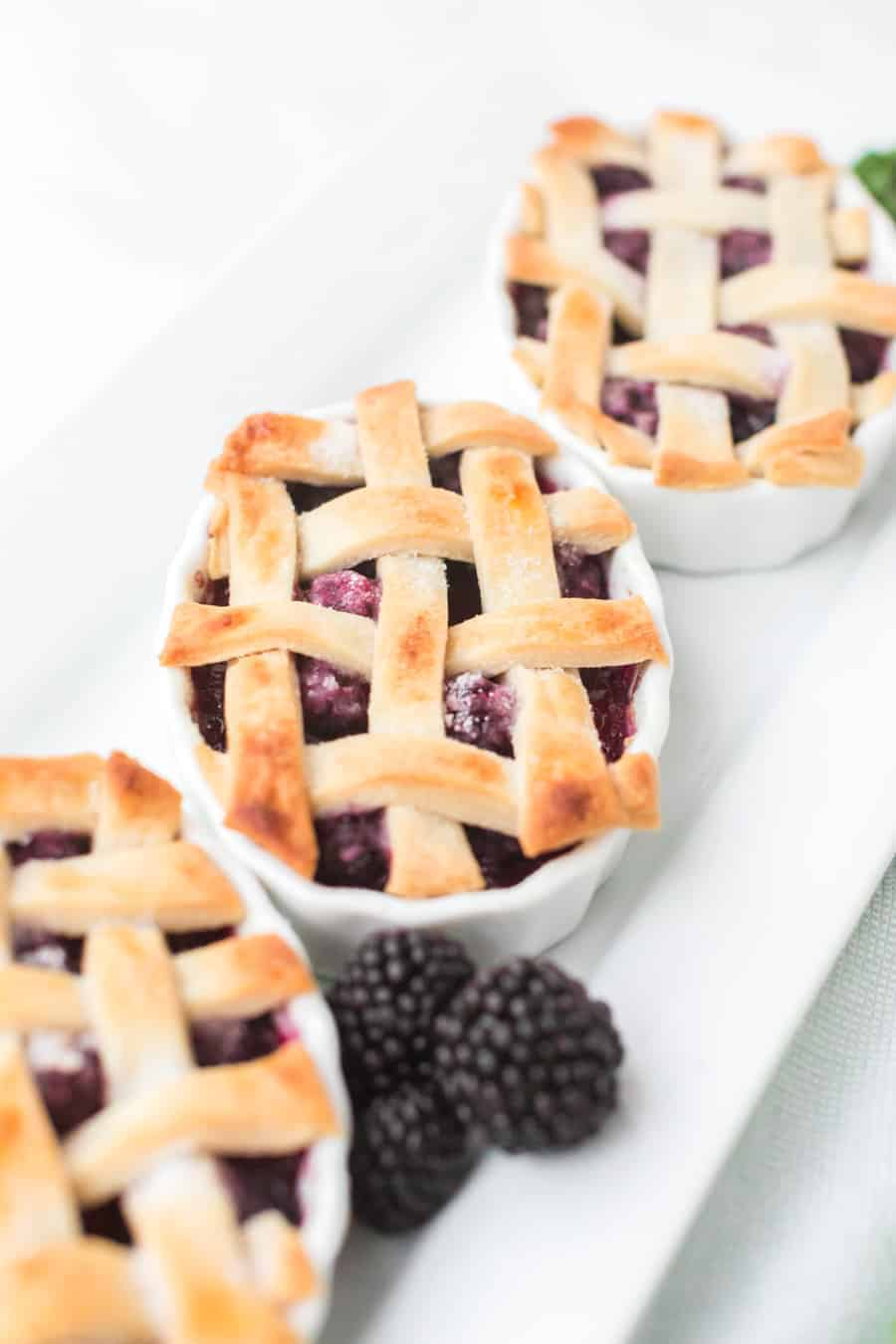 Blackberry cobbler made with blackberries and a flaky pie crust is a favorite family dessert passed down by my grandmother. #blackberrycobbler #cobbler #blackberry #dessert #baking #familyrecipe