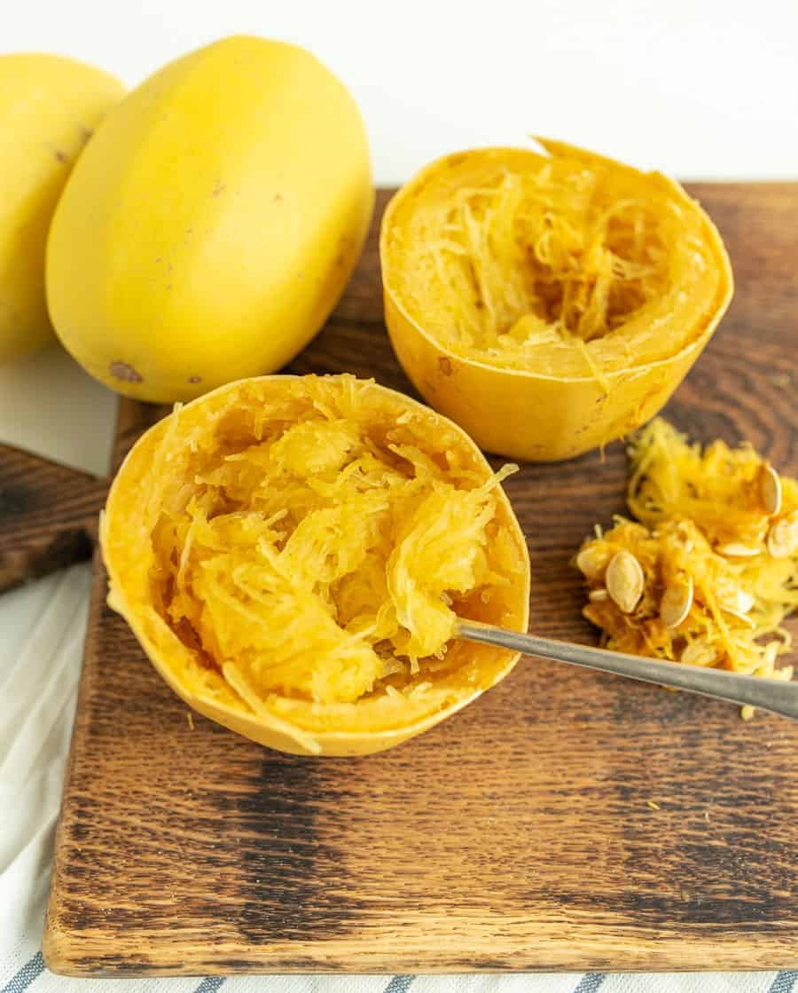 This simple recipe for how to cook a whole spaghetti squash in the slow cooker is the best set-it-and-forget-it hack -- you'll never go back to roasted spaghetti squash! #spaghettisquash #spaghetti #squash #slowcooker #crockpot