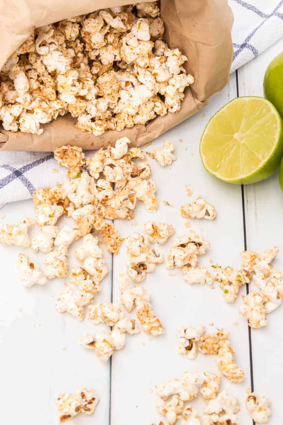 Quick and easy cheesy chili lime popcorn made with fresh popcorn, butter, cotija cheese, and chili powder make one tasty and simple snack. #popcorn #popcornrecipes #savorypopcorn #limepopcorn