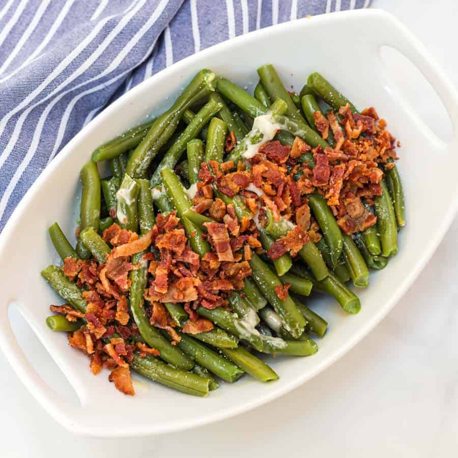 Green beans with butter and bacon is a hearty and flavor-filled side dish that takes green beans from plain to irresistible with just a handful of ingredients. #greenbeans #sides #sidedishes #veggiessides #bacon #southernsides