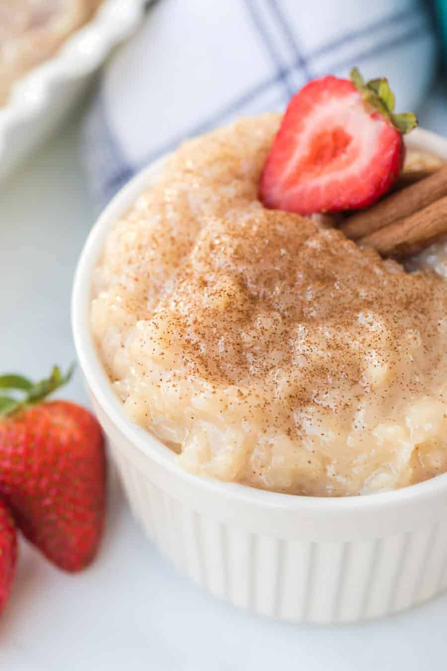 Rice pudding with strawberries in white ramekin