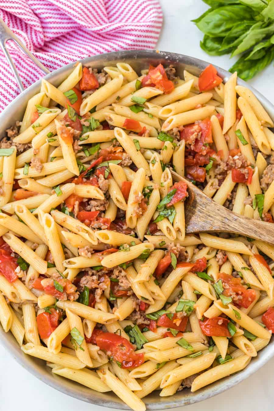 This 30 minute simple roasted tomato and sausage pasta recipe is the easiest comfort food you will ever make, and it tastes wonderful, too! If you appreciate Italian cuisine, this pasta dish is the perfect meal. And literally anyone can make it in no time! It's heaven on a plate from my kitchen to yours. #pasta #pastadinners #dinnerideas #italianfood #easydinners #comfortfood #italiandinners #roastedtomatoes #sausagepasta #penne
