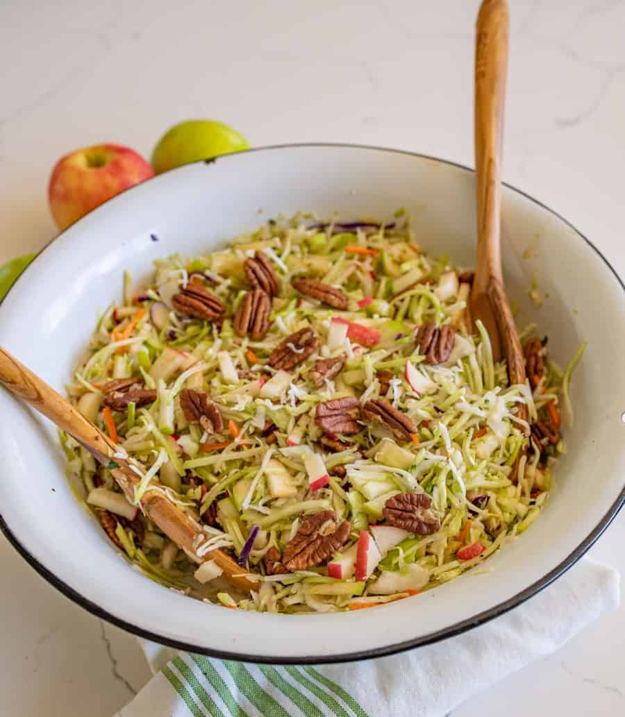 Apple cabbage salad with pecans is a crunchy and bright salad similar to cole slaw with just a hint of sweetness from the fruit. #cabbagesalad #coleslaw #applecabbagesalad #applesalad #cabbage #salad