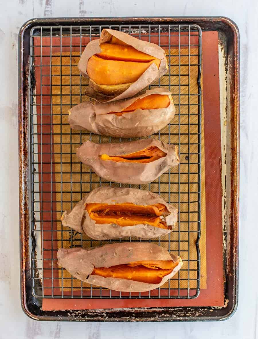 The best method for how to bake a sweet potato to get soft and sweet insides and a skin that's easy to remove. #sweetpotatoes #bakedsweetpotato #sweetpotatorecipe #sweetpotato