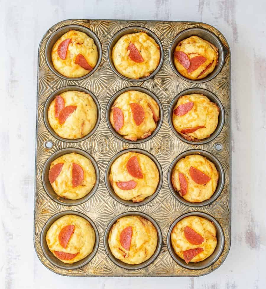 Easy pepperoni pizza muffins bring the delicious and satisfying flavors of pizza to bite-sized snacks you can eat on the go! #pizzamuffins #pepperonipizza #muffins #pepperoni #pepperonipizzamuffins