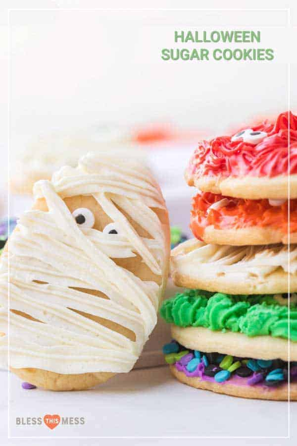 Title Image for Halloween Sugar Cookies with a stack of colorful-frosted cookies and a cookie with mummy decorations