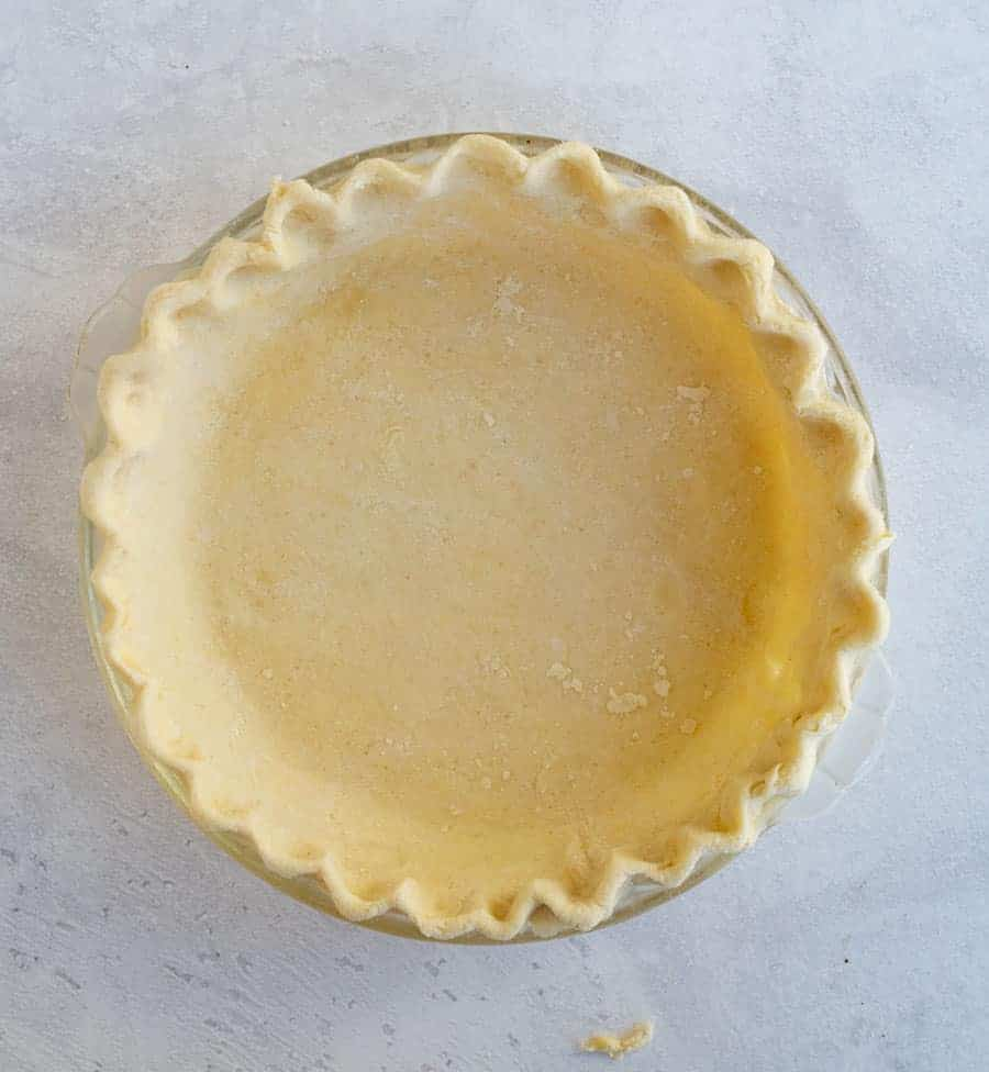 This buttery and flaky all butter pie crust is such a simple recipe with just 4 ingredients, and the perfect crust for all your favorite pies! Get you homemade pie baking on with this super simple, super perfect pie crust made without any shortening as the fat -- just butter! #butterpiecrust #piecrust #piecrustrecipe #pie #pierecipe #allbutterpiecrust #holidaybaking #pies