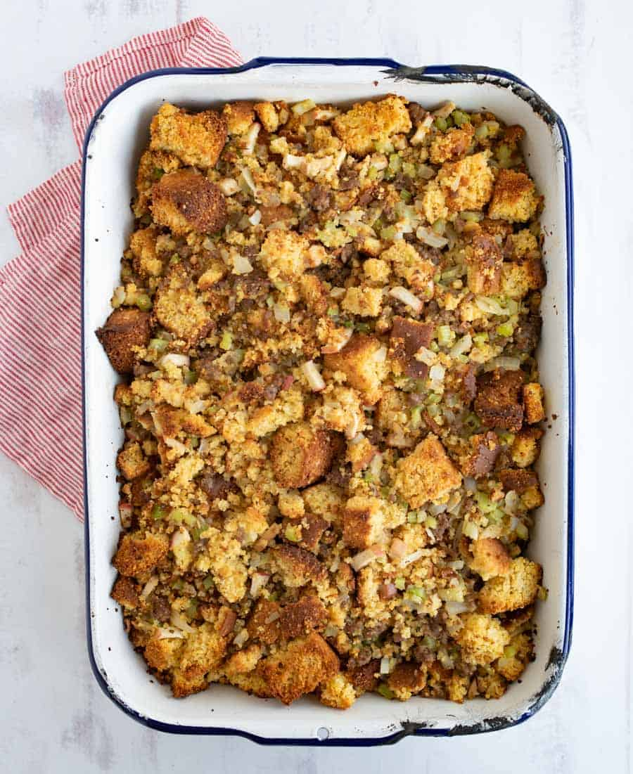 Cornbread stuffing is a crumbly and flavor-packed holiday side dish that's simple to prepare and delicious to enjoy! With sausage, onion, apple, and celery to complete it, this cornbread stuffing is chock-full of fall flavors and is majorly easy to whip up as a side for your holiday feast. #stuffing #dressing #cornbreadstuffing #cornbreaddressing #cornbread #thanksgivingsides #thanksgiving #thanksgivingrecipes #holidayrecipes
