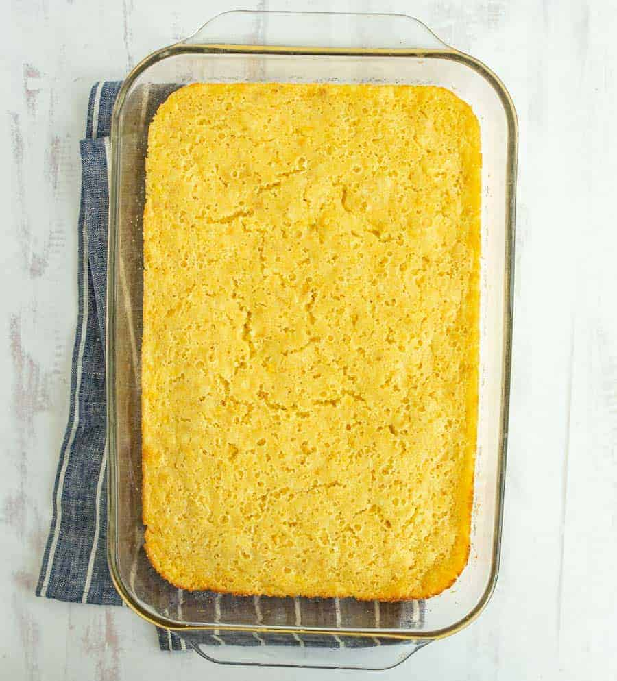 Easy creamed corn casserole is a buttery and creamy dish that's a perfect Thanksgiving side and the absolute easiest casserole to make ever (and that's saying a lot -- casserole is notoriously easy!). This fluffy and rich casserole is such a fun take on a corn side dish, and it's super hearty, delicious, and comes together simply. #corncasserole #creamedcorncasserole #casserole #creamedcorn #thanksgivingdishes #thanksgivingsides #thanksgivingrecipes #holidaydishes