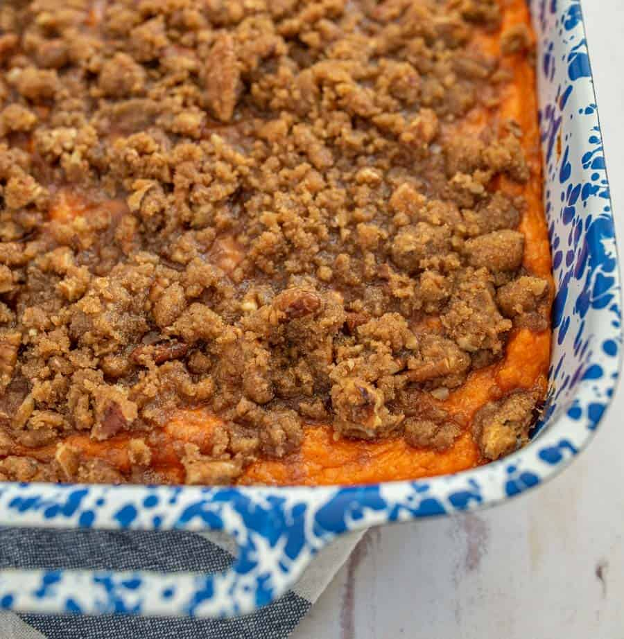 Sweet and fluffy sweet potatoes topped with a crunchy pecan streusel topping, Beth's famous sweet potato casserole is a must-make dish for holiday meals! #sweetpotatocasserole #thanksgivingsides #holidaydishes #sweetpotato #casserole #thanksgivingfood #thanksgivingrecipes #holidayrecipes