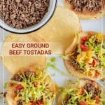 Top view of Easy Ground Beef Tostadas with tortilla shells topped with ground beef, shredded lettuce, diced tomato and shredded cheese