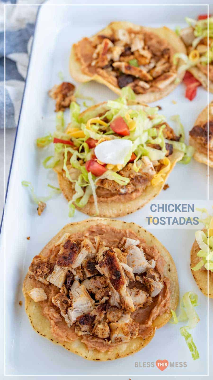 The best chicken tostadas take only 30 minutes to make, including simple baked tostada shells, and the whole family will love them. They come together quickly and they're bursting with flavor, which is kind of the best thing ever when it comes to weeknight meals. #tostadas #chickentostadas #tacos #texmex #mexicanfood #tostadarecipe