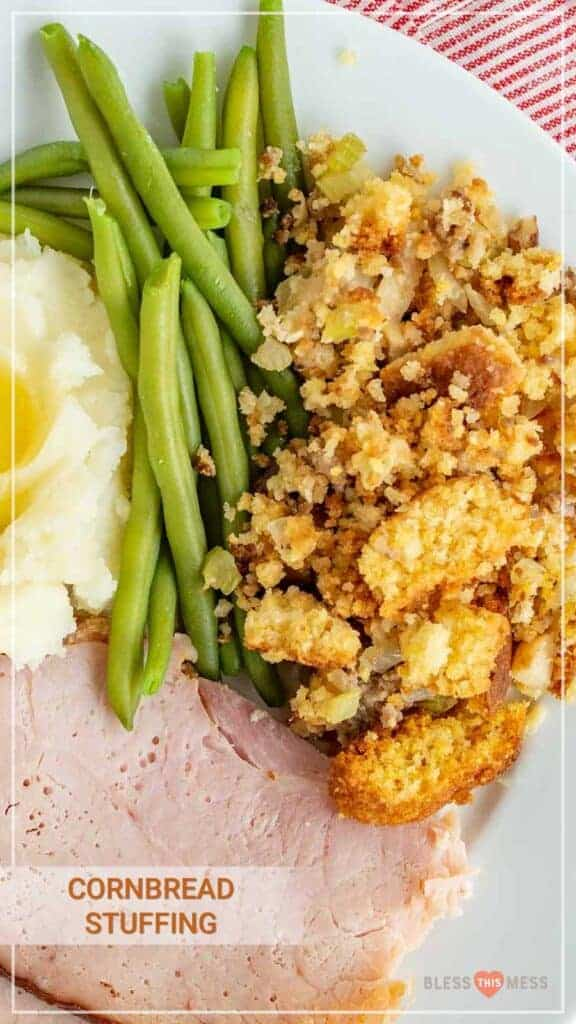 Title Image for Cornbread Stuffing and a white plate with ham, mashed potatoes, green beans, and cornbread stuffing