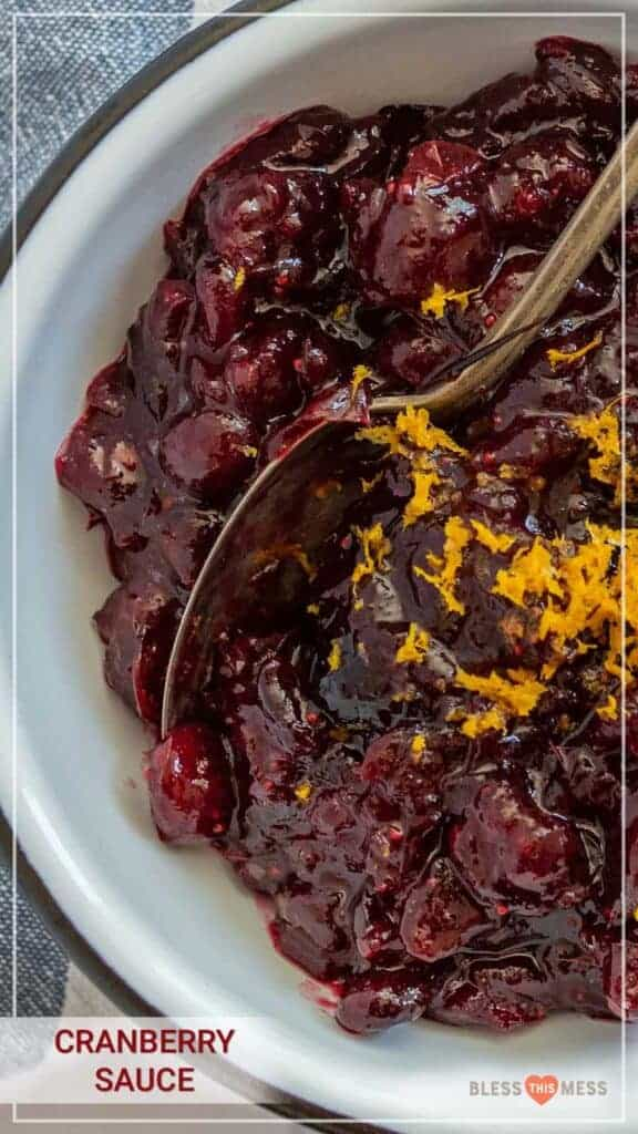 A bowl of homemade cranberry sauce topped with orange zest