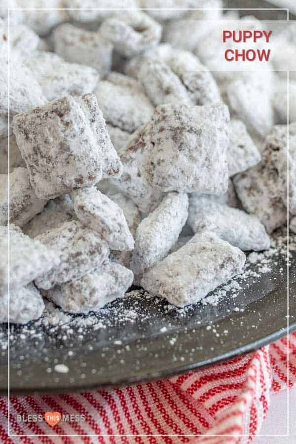 Puppy chow with peanut butter, chocolate, Chex, and powdered sugar is one of the most fun sweet treats ever, and it comes together quickly for a crunchy dessert, easy goody bag, or delicious after-school snack! This homemade puppy chow recipe is one of the simplest and most fun treats to make. I love getting the kids involved because it's so straightforward and a great way to get them interested in cooking and baking! #puppychowrecipe #puppychow #muddybuddies #chexcereal #simpledesserts