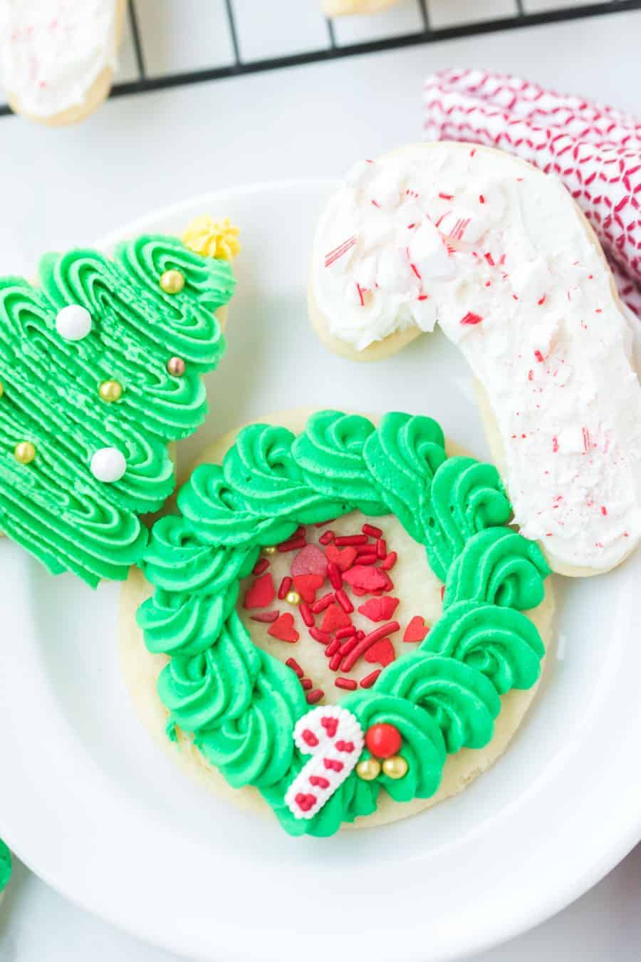 These perfect sugar cookies are moist and soft but keep their shape well, and are perfect for any holiday occasion! They're simple to make, too. Just make the dough, chill it, roll it, shape it, and bake it! And of course, don't forget to decorate it. #sugarcookies #sugarcookie #sugarcookierecipe #baking #cookies #cookierecipe #christmascookies