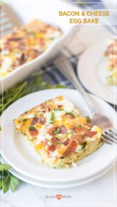 bacon and cheese egg bake on white dish with fork