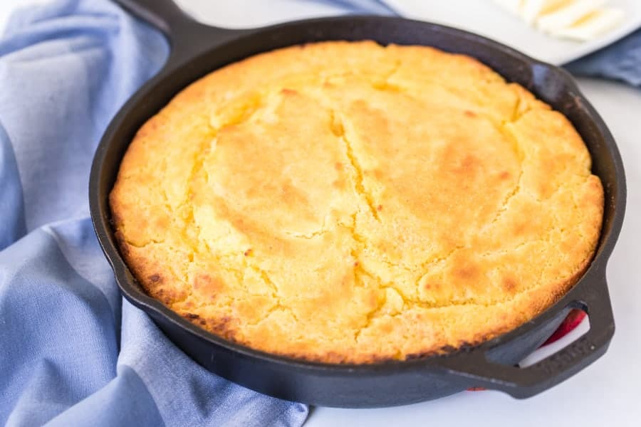 golden cooked cornbread in a cast iron skillet