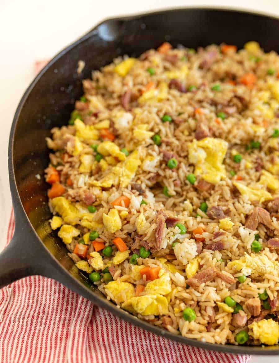 easy fried rice in a skillet on red and white striped towel