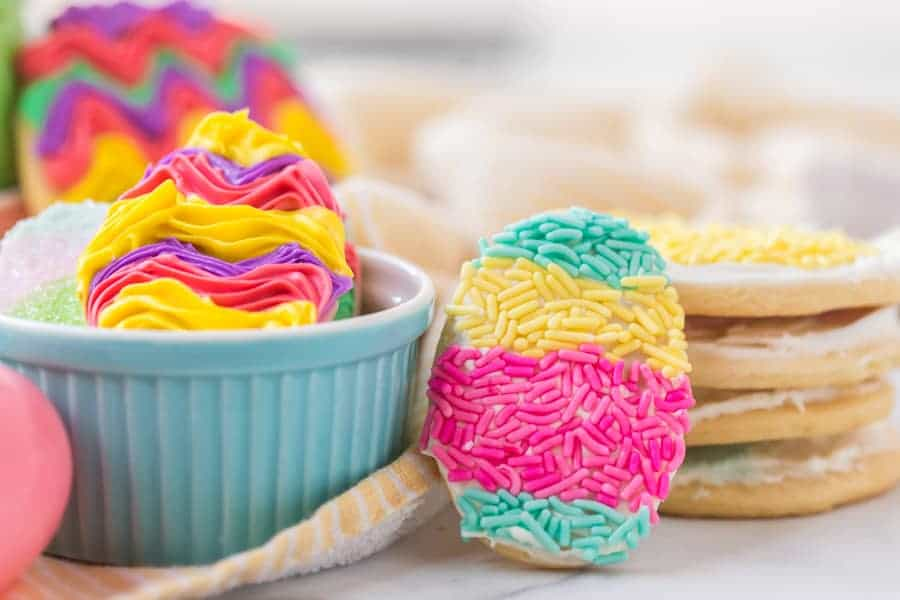 closeup shop of decorated easter sugar cookies with icing and sprinkles
