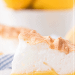 closeup of cheery lemon meringue pie slice with lemons