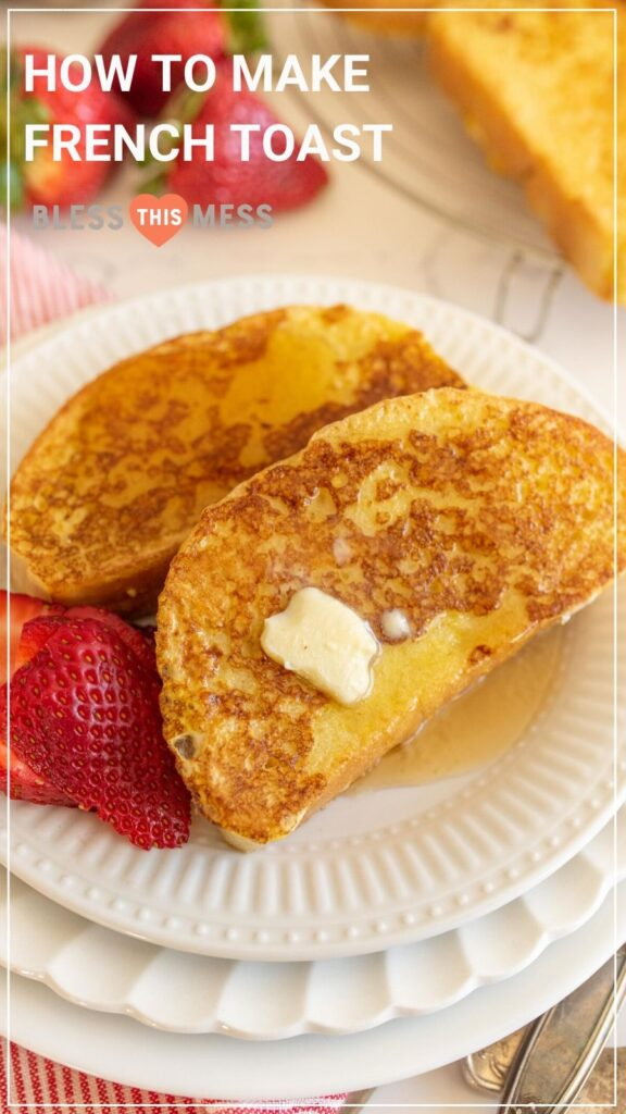 french toast with pat of butter and strawberries on round white plates