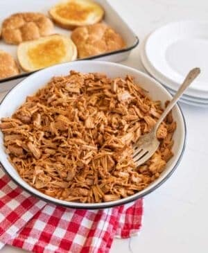 pulled barbecue pork on serving platter with fork