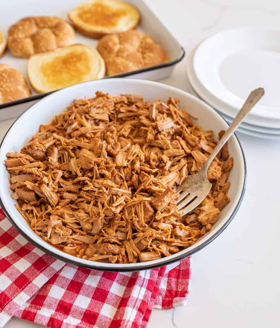 pulled barbecue pork on serving platter with fork
