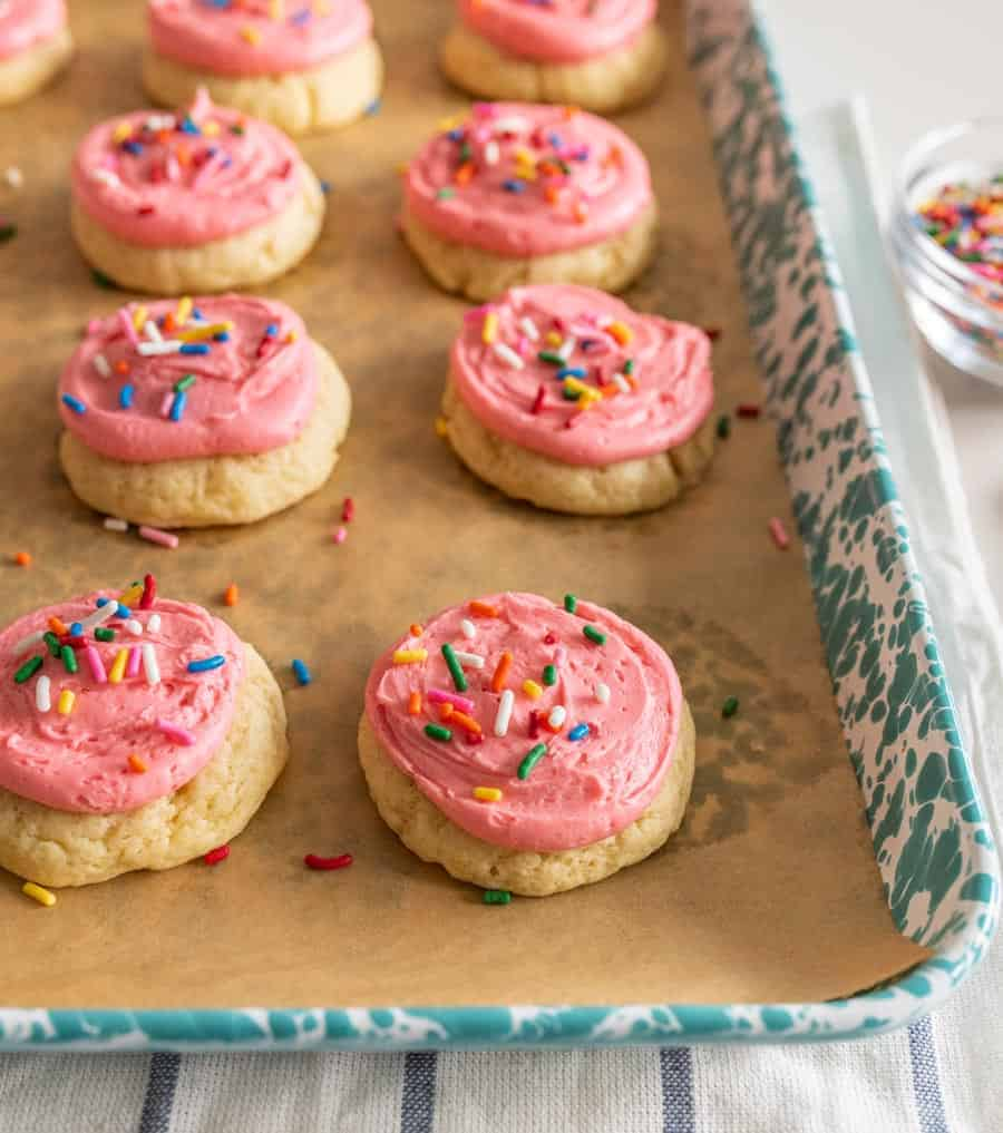 cookies on tray with pink frosting