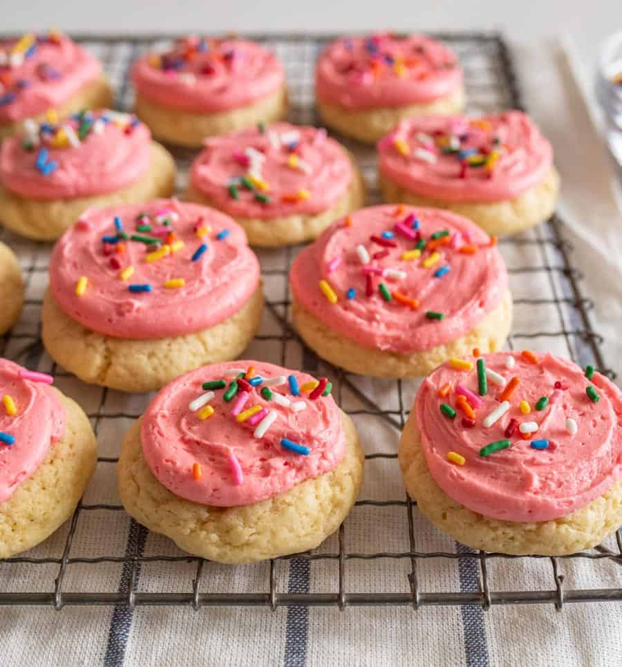 pink frosted cookies on tray