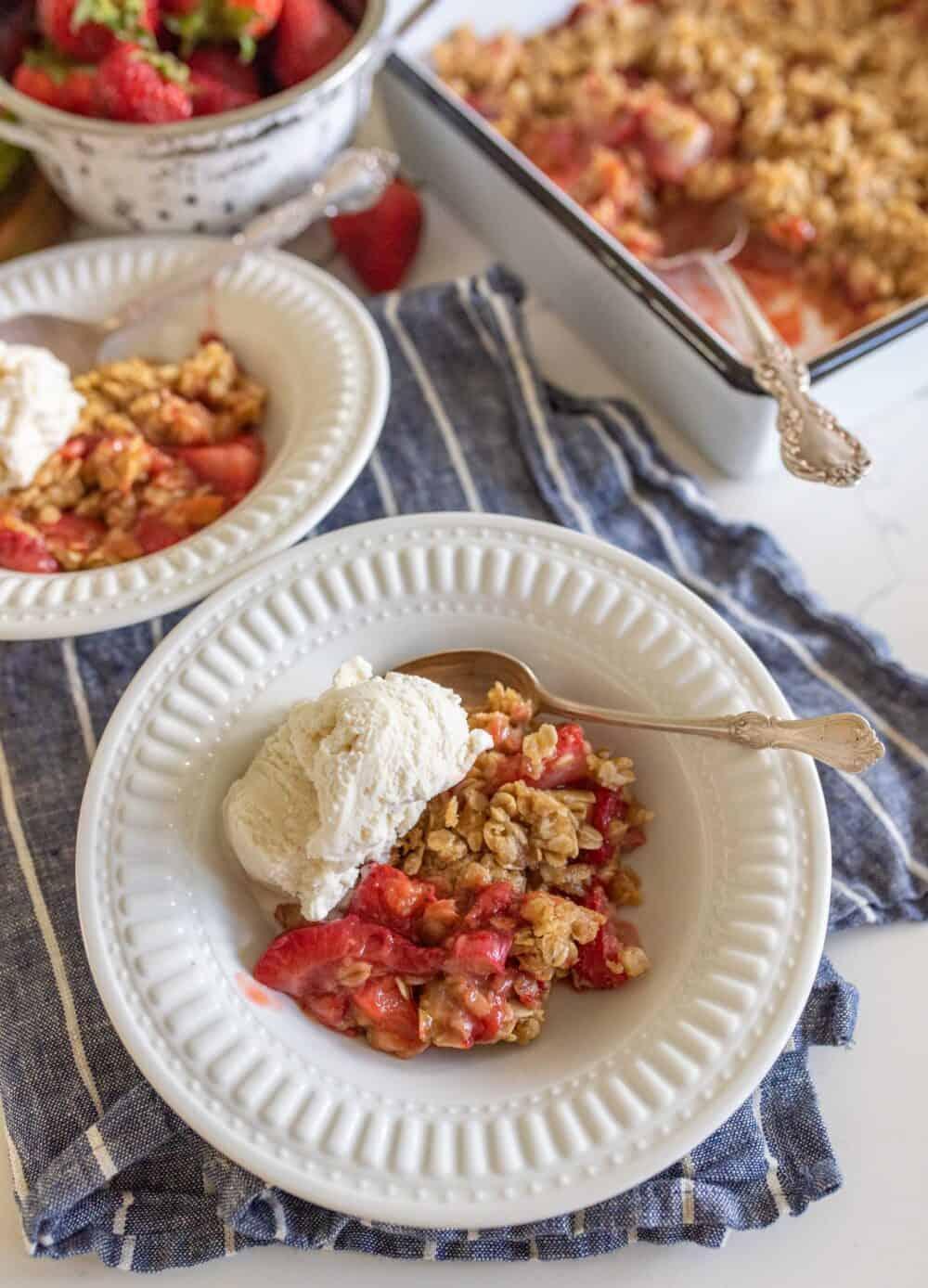 one serving of rhubarb crisp with vanilla ice cream on top