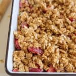 strawberry rhubarb crisp with topping in pan before baking