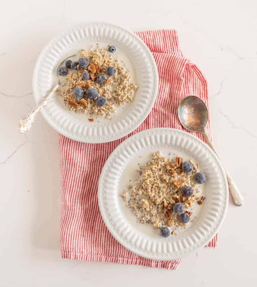 steel cut oats with fruit in white bowls