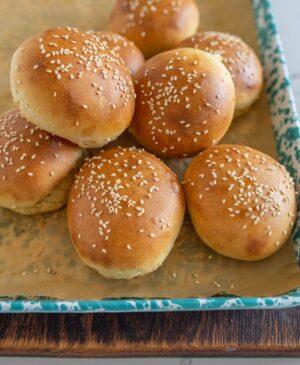 sourdough burger buns on a sheet after baking