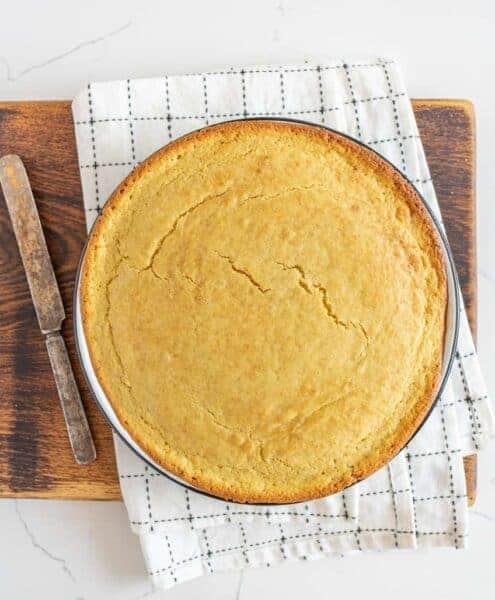 round pan of sourdough cornbread on cutting board