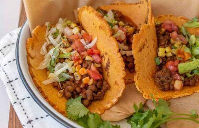 close up of sweet potato tacos in white pan