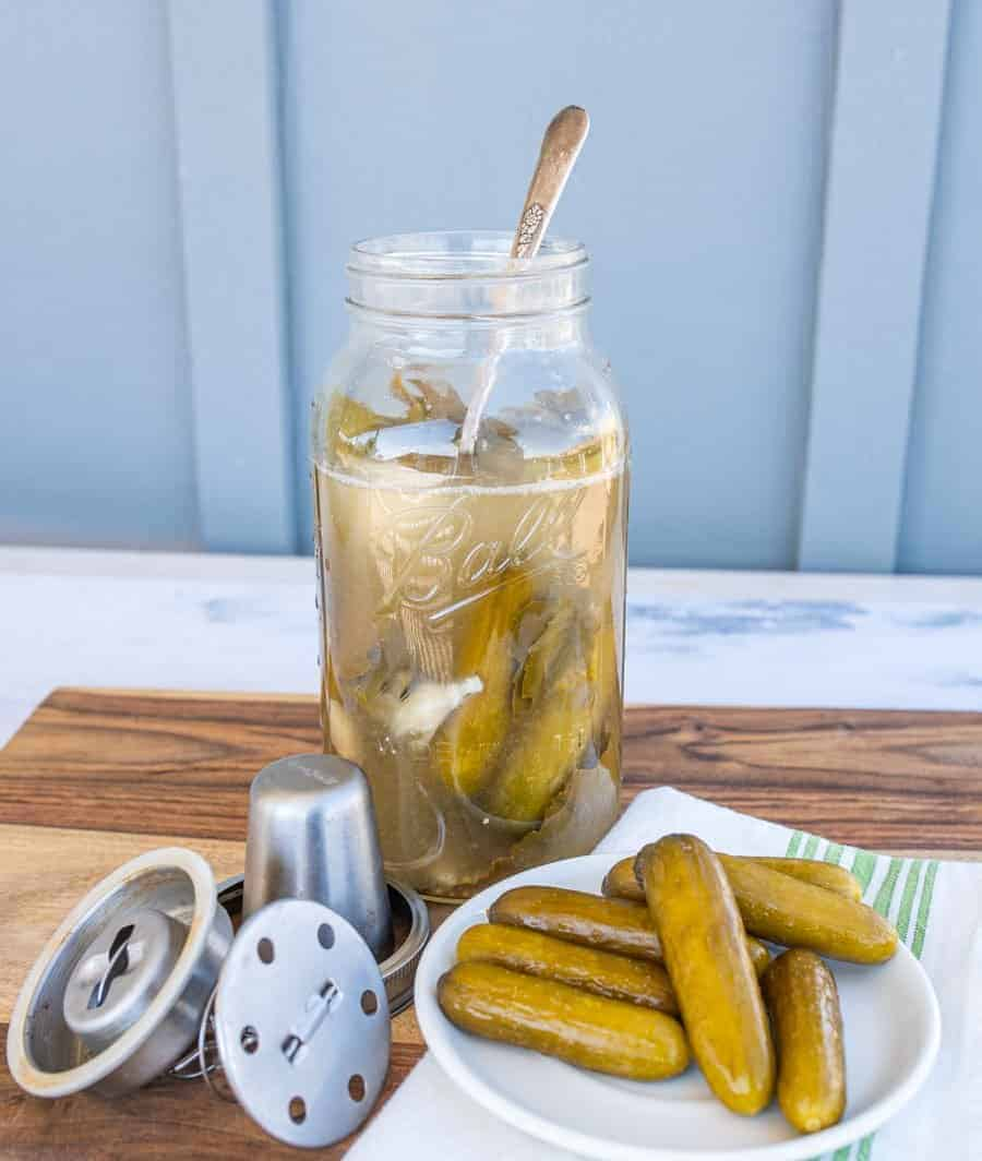 pickles on a plate and in a jar