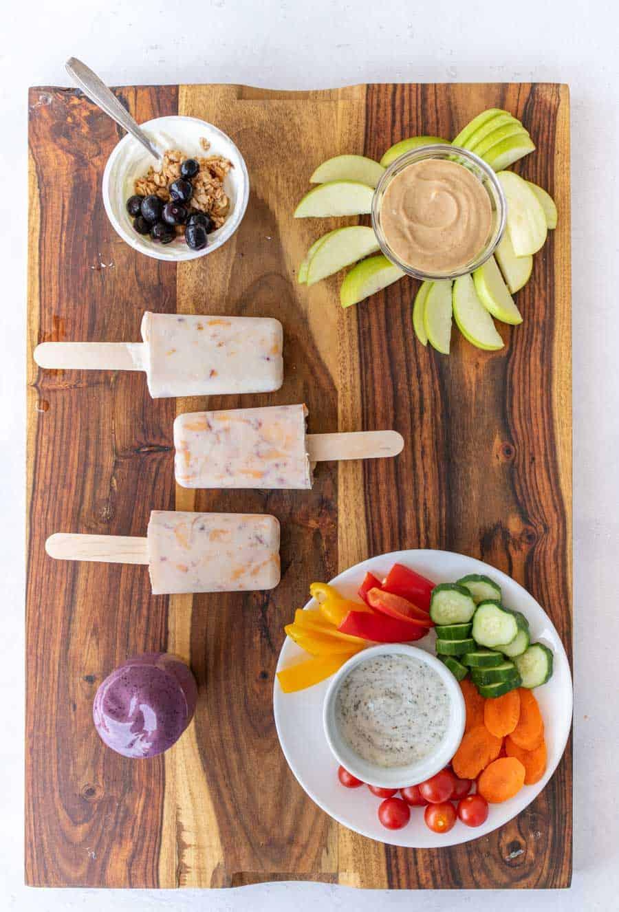 healthy snacks on a wood board