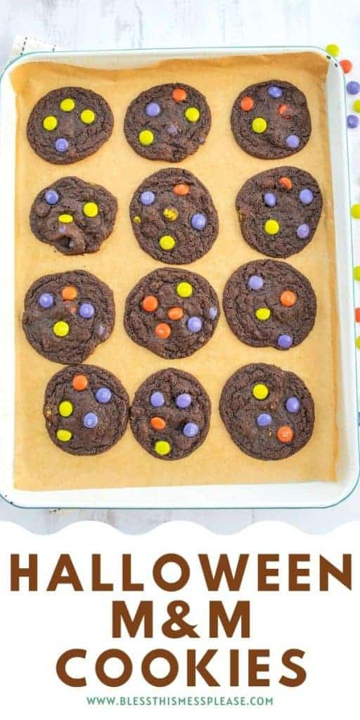 Halloween M&M cookies on baking sheet with text on the image