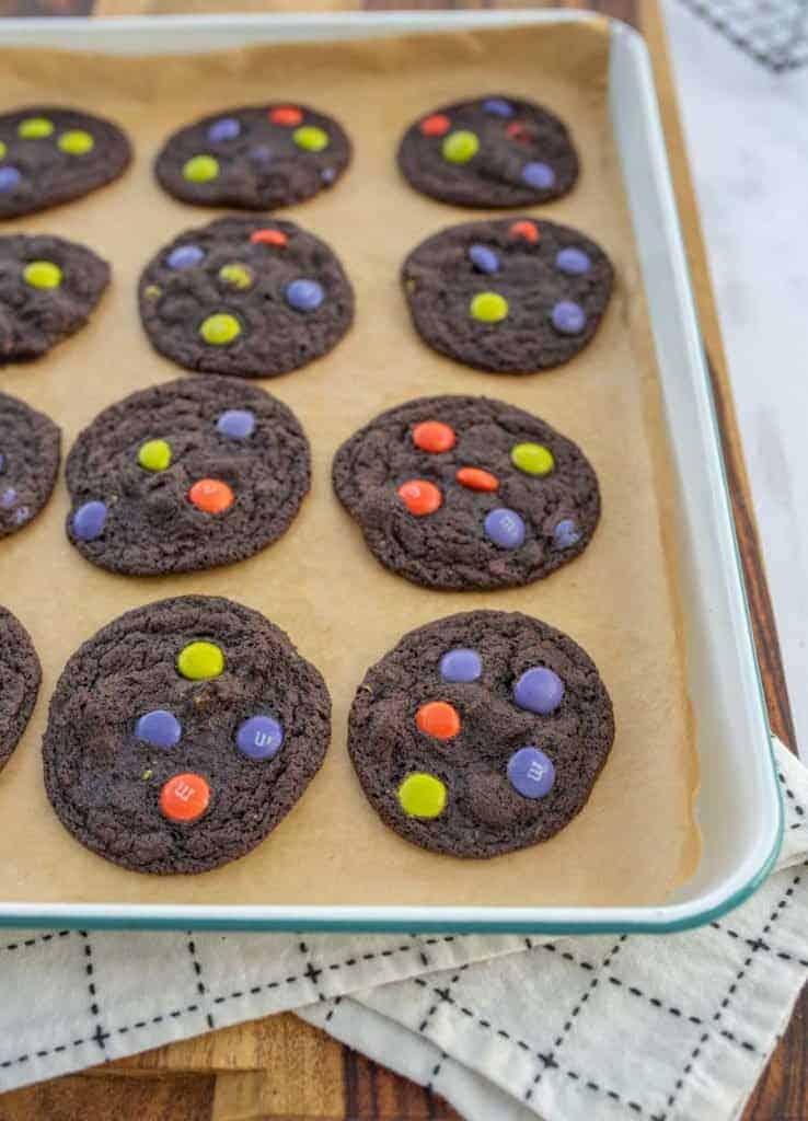 halloween dark chocolate M&M cookies on enamel baking sheet