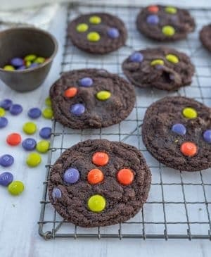 dark chocolate Halloween M&M cookies on cooling rack